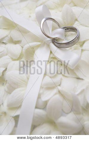 Wedding Rings On Flower Petals  Vertical