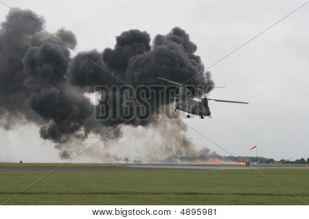 Chinook Flying Away From Explosion