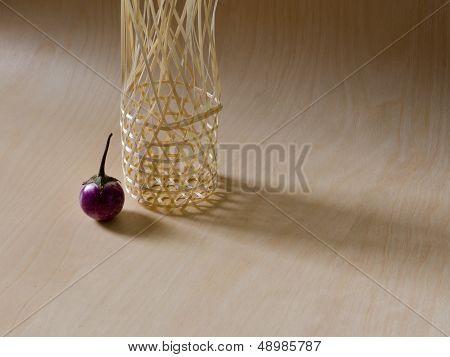 Eggplant And Bamboo Basket