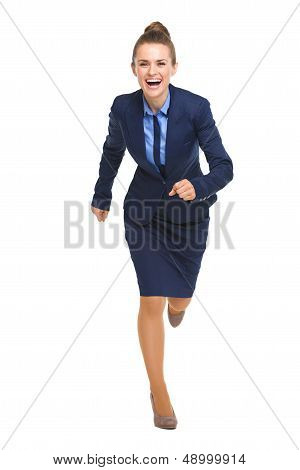 Full Length Portrait Of Happy Business Woman Running Straight
