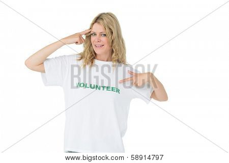 Portrait of a happy female volunteer pointing to herself over white background