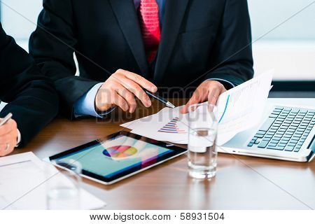 Business - banker, Manager or expert evaluates the figures on tablet computer and compares the development of the business in real time poster