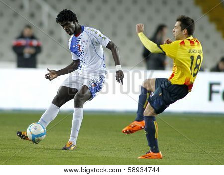 BARCELONA - DEC, 30: Cape Verdean player Pericles Pereira Peks in action during the friendly match between Catalonia and Cape Verde at Olympic Stadium on December 30, 2013 in Barcelona, Spain