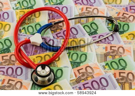 stethoscope and euro bills. symbolic photo for healthcare costs and for health and medicine