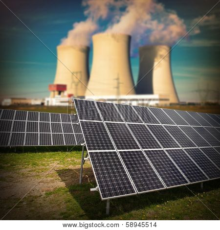 Solar panels against nuclear power plant. Sustainable development and renewable resources concept.