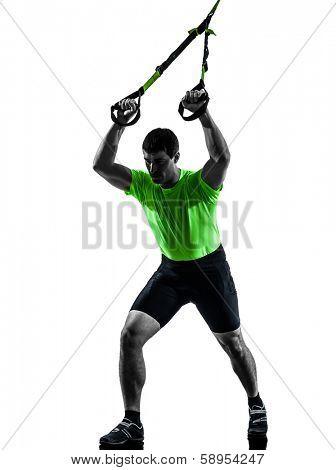 one caucasian man exercising  suspension training trx  on white background