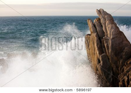 Wave Splashing On Rock