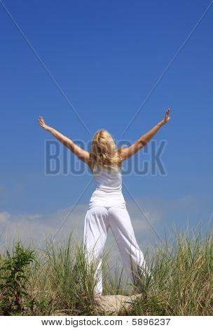 Young Woman Relaxing Among Dunes
