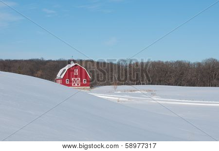 Red barn in winter landscape