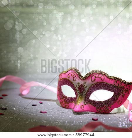 Pink carnival mask with glittering background poster