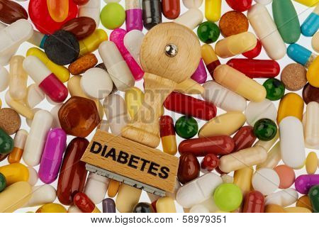 stamp on colorful tablets, symbol photo for diabetes, prescription and medication