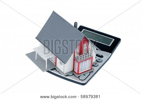 residential building on a calculator, symbolic photo for home purchase, costs and savings