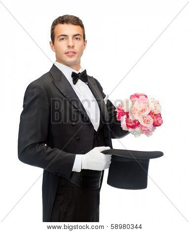 magic, performance, circus, show concept - magician taking out of top hat flower bouquet