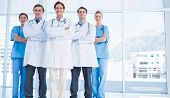 Group portrait of young doctors standing together at the hospital poster