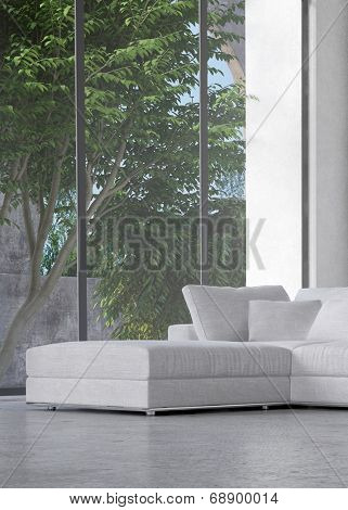 Lounge interior overlooking trees in a courtyard through a large floor-to-ceiling glass window with a modern ottoman and suite in the corner