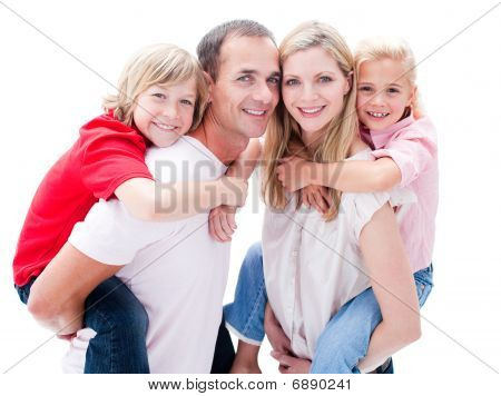 Portrait Of Parents Giving Their Children Piggyback Ride