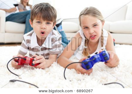 poster of Animated children playing video games lying on the floor