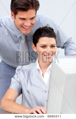 Confident Business Woman And Her Colleage Working At A Computer