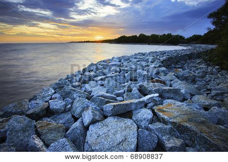 sun set with rock dam sea coast bank protection perspective line poster