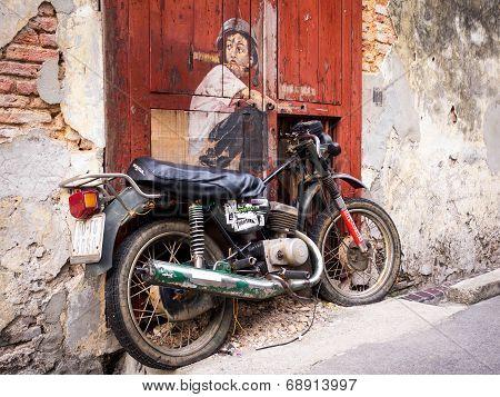 Boy On Bike Street Art Mural In Georgetown, Penang, Malaysia