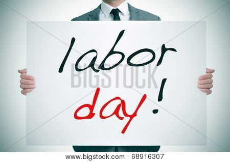 a man wearing a suit holding a signboard with the text labor day written in it poster