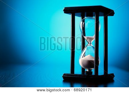 Egg Timer Or Hourglass On A Blue Background