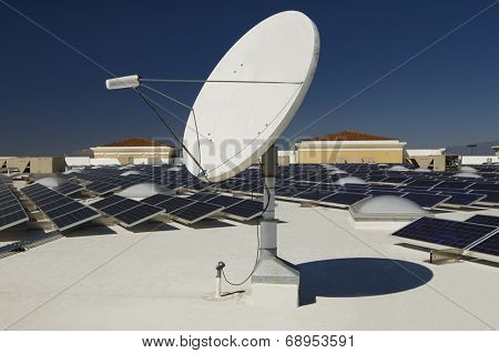 Solar panels and satellite dish at solar power plant