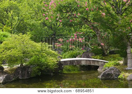 Japan, Himeji, Himeji Koko-en Gardens, stone bridge over stream