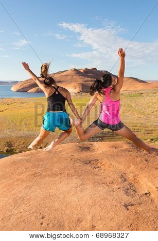 Two Happy And Jumping Girls