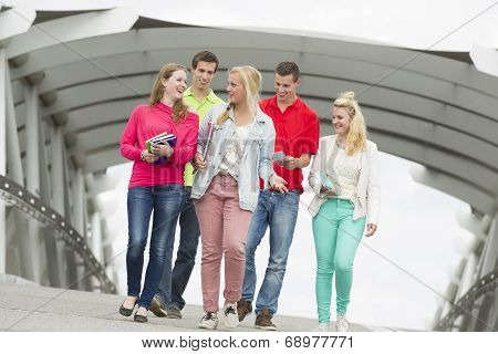 Five Students Walking On A Bridge