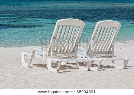 Sun Loungers Facing The Caribbean Sea