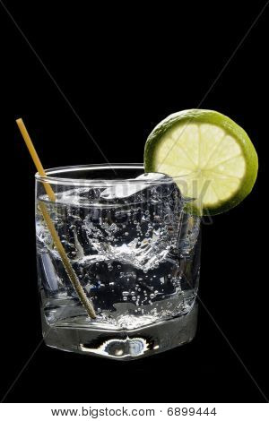 Club Soda Or Gin / Vodka Tonic Cocktail On A Black Background