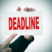 woman hand holding a signboard with the word deadline written in it poster