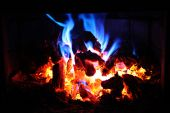 Fire in Fireplace with red and blue flames poster
