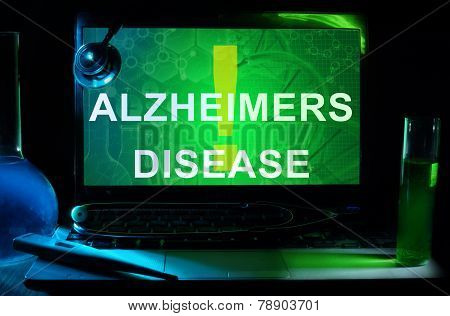 Notebook with words Alzheimers Disease