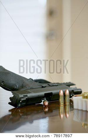 Gun at door with ammunition