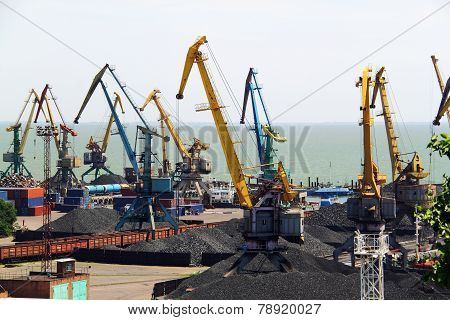 Seaport With Cranes And Coal