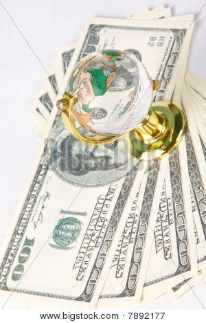 Glass Globe And Dollars