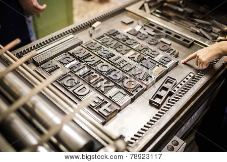 Old typography printing machine with font characters for craftman typography poster
