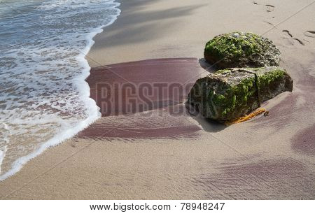 Sandy beach with red mineral deposits in Tangalle Southern Province Sri Lanka Asia. poster