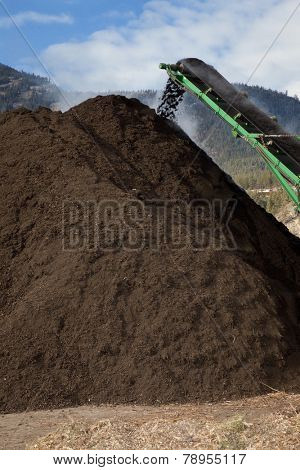 Photo of large amount of compost being produced.