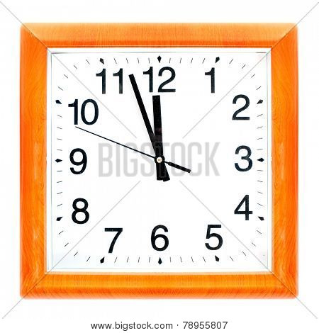 At the eleventh hour on a retro clock with wooden frame.
