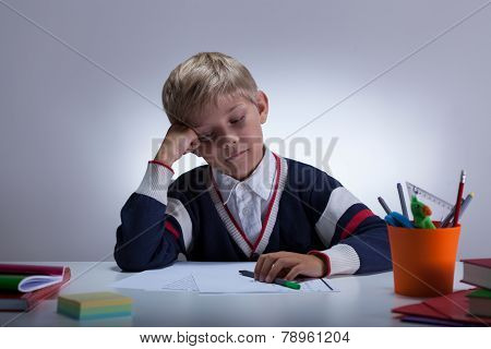 Bored Student Sitting At The Desk