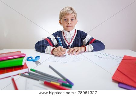 Schoolchild at the sweater doing wordsearch at the desk poster