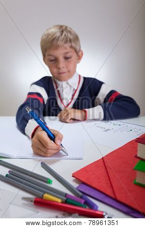 Child Writing In Notebook