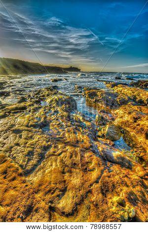 Orange Rocks By The Shore In Porto Ferro Beach