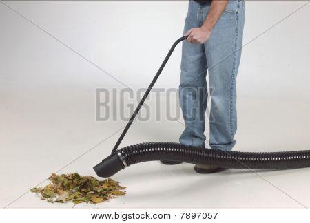 man with leaf vacuum