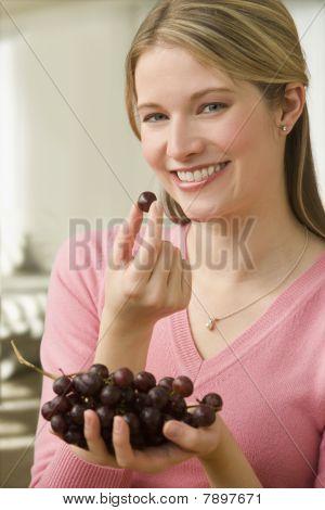 Woman Eating Grapes