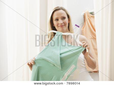 Woman Looking at Dress