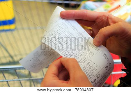 Supermarket. Paper Check Receipt Bill In Hand.